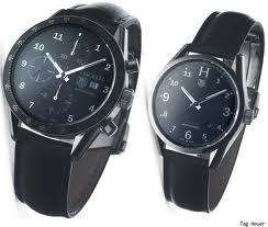 a pair of TAG Heuer watches