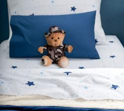 bed and teddy bear