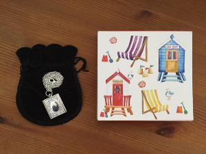 Book related locket necklace & seaside themed notebook from Bella Osborne