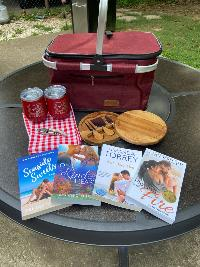 Four signed paperbacks from authors Melissa Chambers, Amy Knupp, Amanda Torrey, and Christine DePetrillo. An insulated picnic basket. A mini cheese board set. A corkscrew.Two Booktrippers insulated wine tumblers. + much more!!