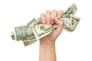 hand holding U.S. currency
