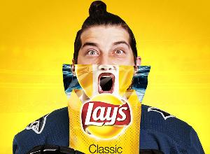 man and Lays chips