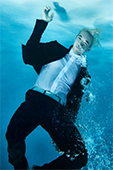 man in suit under the water