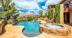 nice pool at back of house, mountains in background