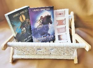 One winner will receive: A copy of Plague of Flies by Laurel Ann Hill, A copy of Engine Women's Light by Laurel Ann Hill, Macramé and wood book/magazine holder & 5 magnetic desert design magnet book marks!