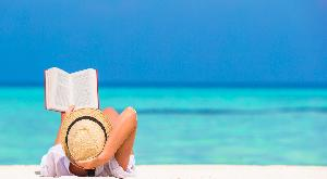 person reading on a beach