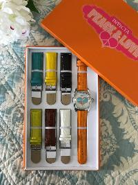 photo of the watch with heart-shaped peace sign on face and the 7 different color watch straps