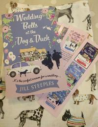 Signed paperback copy of Wedding Bells at The Dog & Duck, a cute doggy tea towel & bookmarks from Jill Steeples