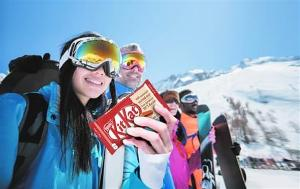 skiers holding a kit kat