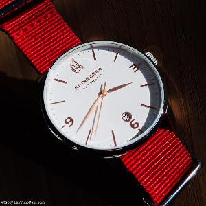 Spinnaker Capri Automatic watch with white dial and red NATO strap.