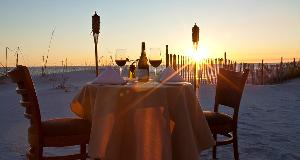 table on beach for sunset dining