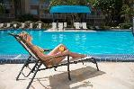 girl on lounge chair by pool