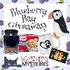 One lucky winner will receive a paw-some prize pack inspired by Blueberry Bay including a blueberry muffin-scented candle, an animal lover's mug, a muffin-in-a-mug kit, a plush Puffin, and a $10 Amazon gift card!