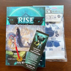 Win a prize pack featuring - Signed Copy of Rise Paperback, Kendo themed Tenugui towel, Rise bookmark, Lucky Coin charm, Okina kitsune art Print by TeaFoxIllustrations!!