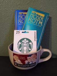 Win a prize pack including a $25 Starbucks gift card, candy bars and a mug!
