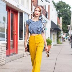 woman in bright yellow pants